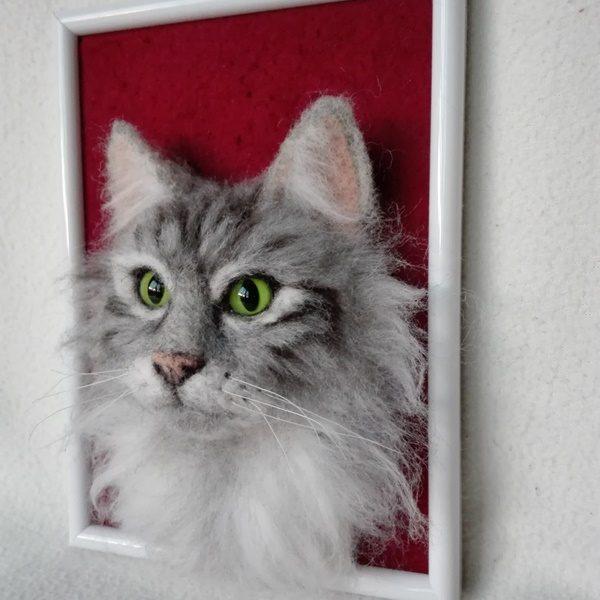 tűnemezelt cica portré